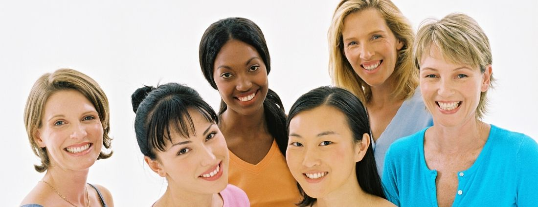 group of ladies smiling all nationalities