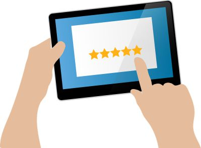 hand holding ipad with five star review